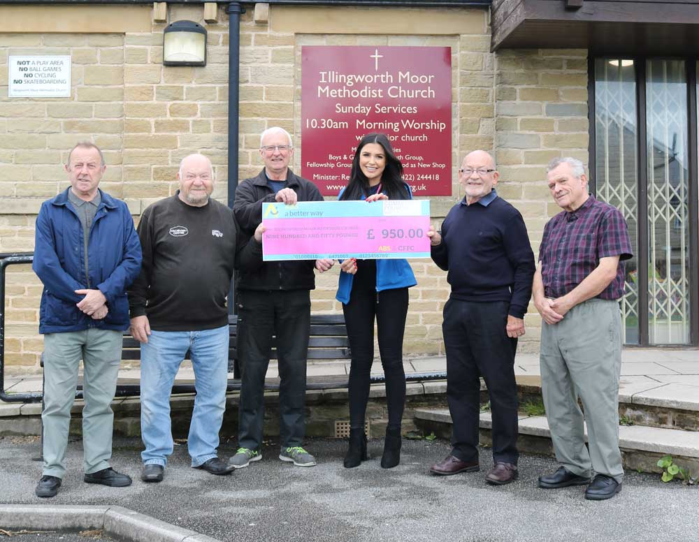 Hannah-presenting-cheque-to-immc